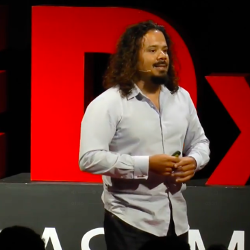 A picture of Beckett Haight giving a TED talk about why coding shouldn't be mandatory.