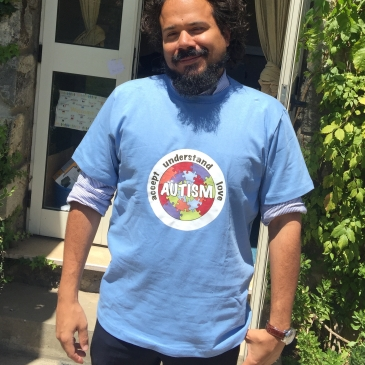 This is a picture of Beckett Haight wearing an Autism Awareness shirt outside his classroom in Addis Ababa, Ethiopia